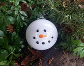"Snowman Head Ornament, 4"" Round Blown Glass Holiday Frosty Ornament with Black Glass ""Coal"" Eyes and Orange Carrot Nose, Avalon Glassworks"