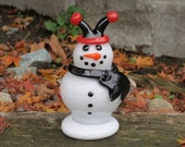 "Glass Jester Snowman Sculpture, Black and Red Hat, Black Scarf, Orange ""Carrot"" Nose, Black Eyes, Smile, Buttons, By Avalon Glassworks"