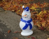 "Glass Snowman Sculpture with Blue Scarf and Hat, Black Eyes, Smile, ""Carrot"" Nose, By Avalon Glassworks"