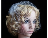 On side  Bridal White or Ivory Russian face veil with Swarovski crystals. Brand new with comb ready to wear