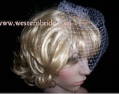 On side  Bridal Ivory Russian face veil with Swarovski crystals. Brand new with comb ready to wear