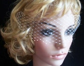 Ivory net veil for brides face  Venetian style. Decorated with Swarovski crystals 3 rows on the edge. with combs on each side ready to wear.