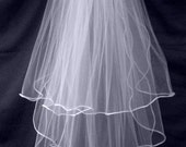 3 tier fingertip veil.  satin edge white or ivory choice of color with silver comb ready to wear