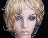 Ivory Birdcage veil . Full veil made with Russian nes and decorated with Swarovski crystals. With comb ready to wear.