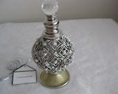 Perfume display decorated bottle, silver wire and faux pearls decor. 4.5 quot x 2.5 quot , screw on stopper w glass ball. Elegant.