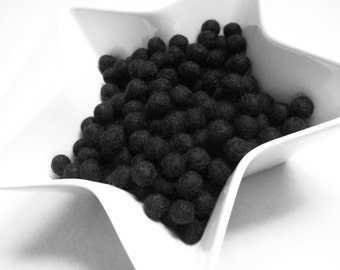 1cm felt balls - 25 black pure wool beads