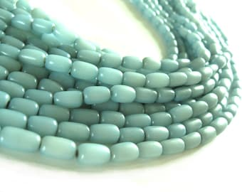 ON SALE! Natural beads soft blue buri nut tube beads 11x7mm