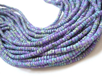 150 coconut beads marblized aqua and purple splashing 4-5mm