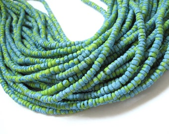150 coconut beads marblized aqua and green splashing 4-5mm