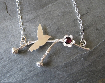 Necklace of Dogwood Twig, Garnet, and Bird in Sterling Silver