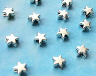 100 very tiny star beads, smooth/plain, shiny silver tone, 5mm