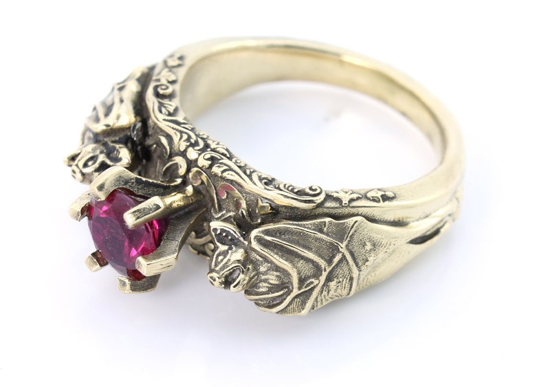 18 kt Gold Bat Ring with Ruby image 0