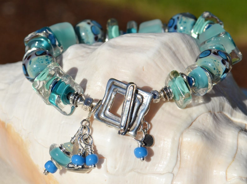 Handmade Lamp Work and Sterling Silver Bracelet BLUE LAGOON Reserve for Annie