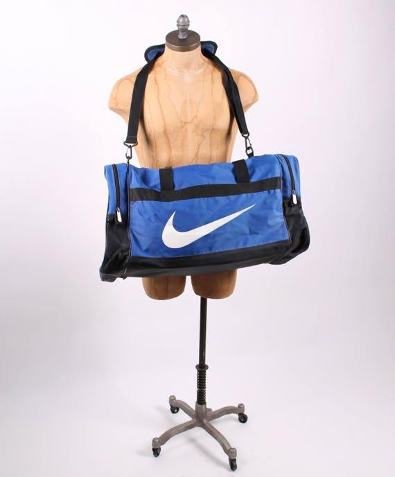 f45b30884ac Vintage NIKE back pack duffle gym bag swoosh shoulder bag blue   Etsy