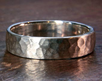 Recycled sterling silver 5mm wide wedding ring. Heavy planished finish. Hand made in the UK.