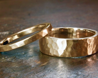 "18 carat ""Fairtrade"" yellow gold 6mm and 2mm wide hammered wedding rings. Matching unisex or his and hers. Hand made in the UK."