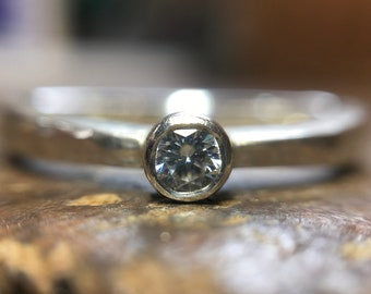 Ethical recycled engagement ring. Handmade in the UK. Sterling silver or gold, set with lab grown moissanite