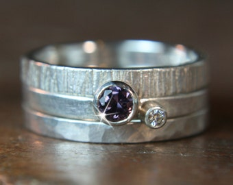 Recycled sterling silver textured stacking ring set. Ethical lab grown moissanite, fair trade purple spinel,  Hand made in the UK