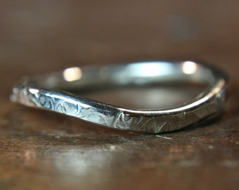 "Recycled sterling silver ""curvy"" textured wedding ring. Hand made in the UK"