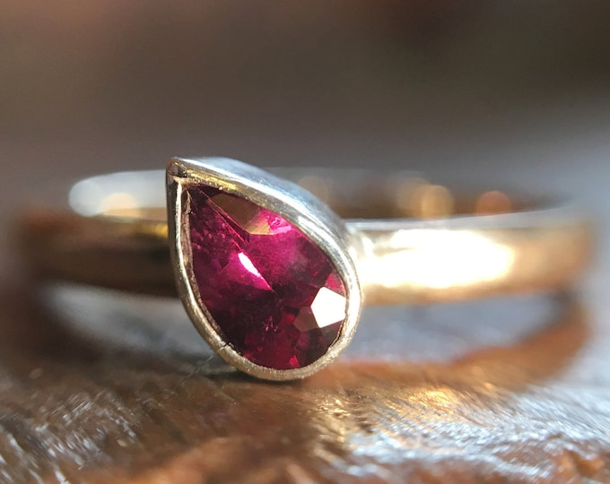Fairtrade or recycled yellow and white gold, ethically sourced pear grape garnet.