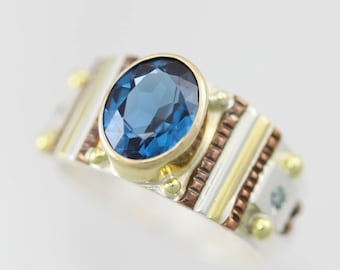 Oval Totem Solitaire Ring 14k 4th (Blue Zircon) Made to Order