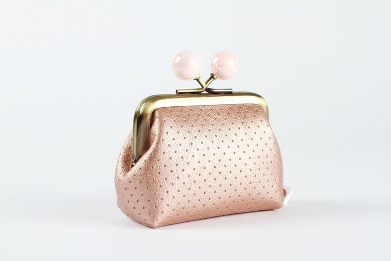 Metal frame coin purse with color bobbles