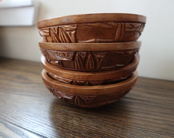 Set of 4 hand carved tribal pedestal wooden bowls