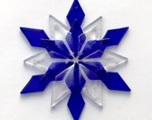 Fused Glass Snowflake Ornament/Suncatcher: cobalt blue & iridized clear - skier gift, artist gift, winter solstice gift, client gift