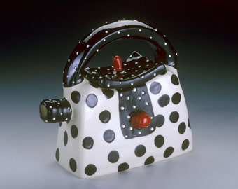 Black, white and red handbag teapot