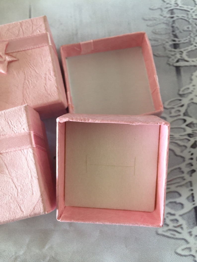 Small pink gift boxes