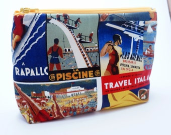 Cosmetics puse in colourful cotton toiletries bag in retro poster print pastic lined