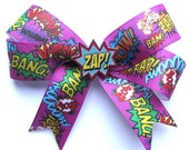Comic hair clip Sound FX print ribbon with illustrated Zap charm by Dolly Cool Pow Bang Boom Bam Superhero