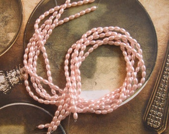 2 Pink Glass Rice Pearl Beads 6x4 MM. 2 - 15.5-16 Inch Strands