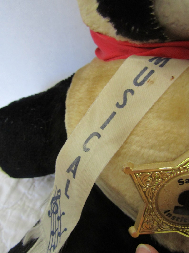 Vintage Stuffed Bear Musical Large with a badge reading Savings Institute