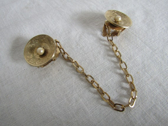 Vintage Sweater Clip sweater guard gold tone metal faux pearls Rhinestones and Religious Medal in Center