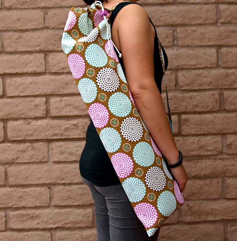 Yoga mat bag handmade with pocket in a neutral taupe with bursts of pink and light teal color in the shape of mums or pom poms BURST