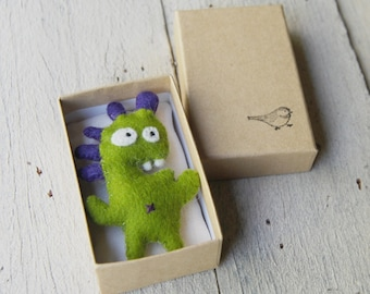 little felt monster in a box