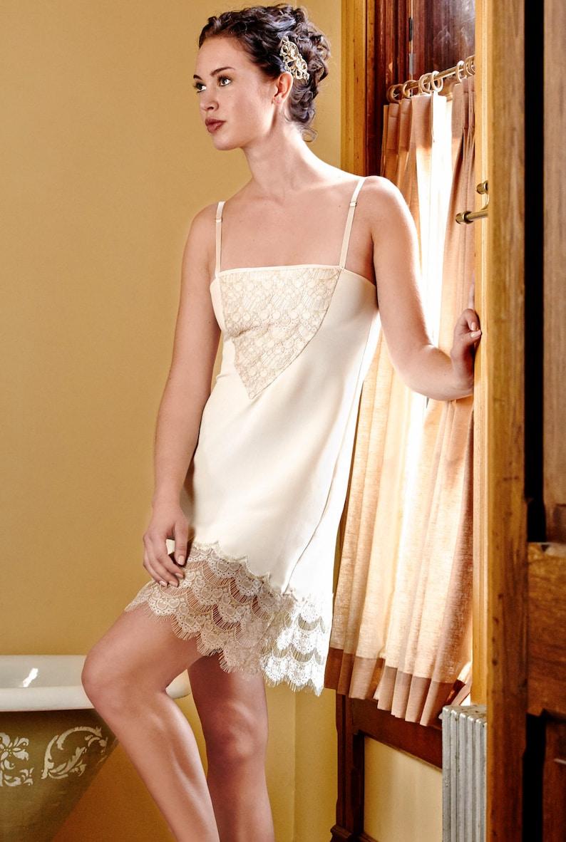 1920s Lingerie History- Underwear, Slip, Bra, Corset Century Girl Slip ivory silk w/ handcut gold lace $190.00 AT vintagedancer.com