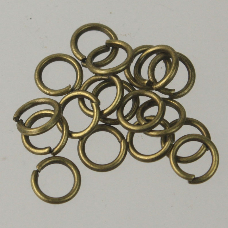 8mm Jump Rings, 100 Antique Brass Jump Rings / Bronze Open 8x1.2mm 16 Gauge 16G Link Connector Open Jump Rings O Ring photo