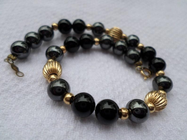 72a176f94328fe 14k gold and black onyx hematite beaded bead BRACELET   Etsy