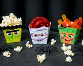 Halloween Popcorn Boxes Cute Monsters Frankenstein, witch, and mummy foldable DIY paper boxes for treats, candy, twizzlers, caramel corn