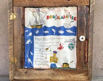 Cabinet from Reclaimed Adobe House Wood with Vintage Bouillabaisse Recipe Handkerchief in Door by Stephanie Barnes-Barneche Design