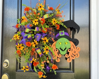Fun not scary Halloween Witch Wreath for Front Door with artificial Flowers and Ribbon Bow