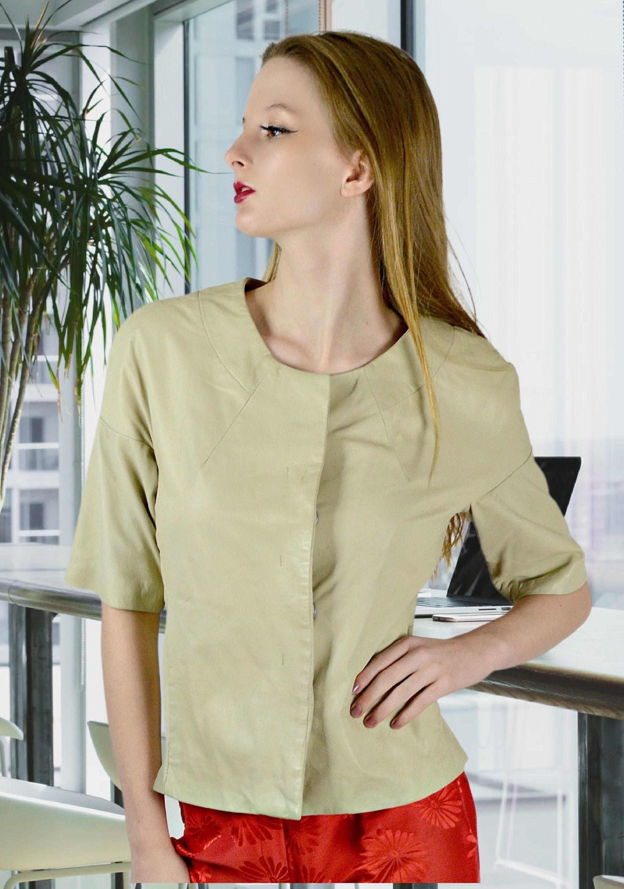 Vintage Scarf Styles -1920s to 1960s Short Sleeved Leather Top, Vintage Kid Skin Blouse, Modern Minimalist Shirt, 90S Beige Everyday Chic Work Top $73.80 AT vintagedancer.com