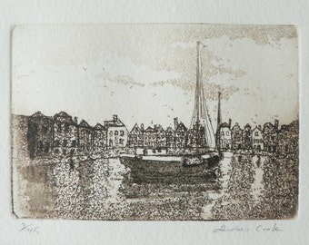 original etching of a harbor town and sailing boat