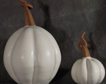 White pottery pumpkins, set of two