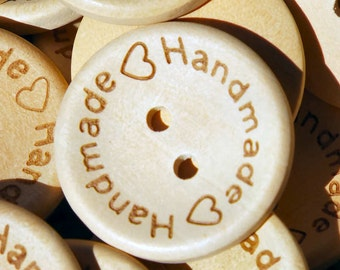 """25 wood buttons,  2 hole, 1"""" round, light color, natural wood buttons, 2 hearts, say Handmade"""