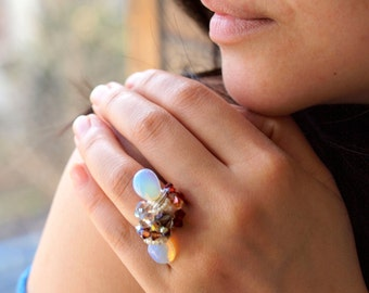 Twin opal cocktail ring wirewrapped in sterling silver sculpture band