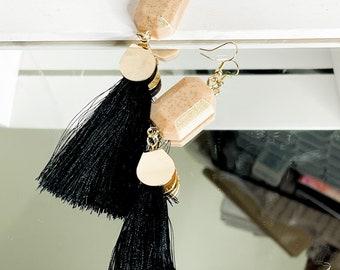 nude and black dangle tassel earrings