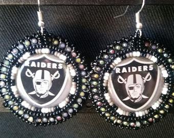 Native American beaded black Raiders cab earrings